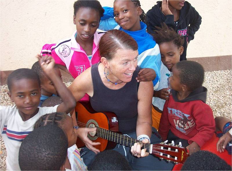 MaryBeth singing with the kids